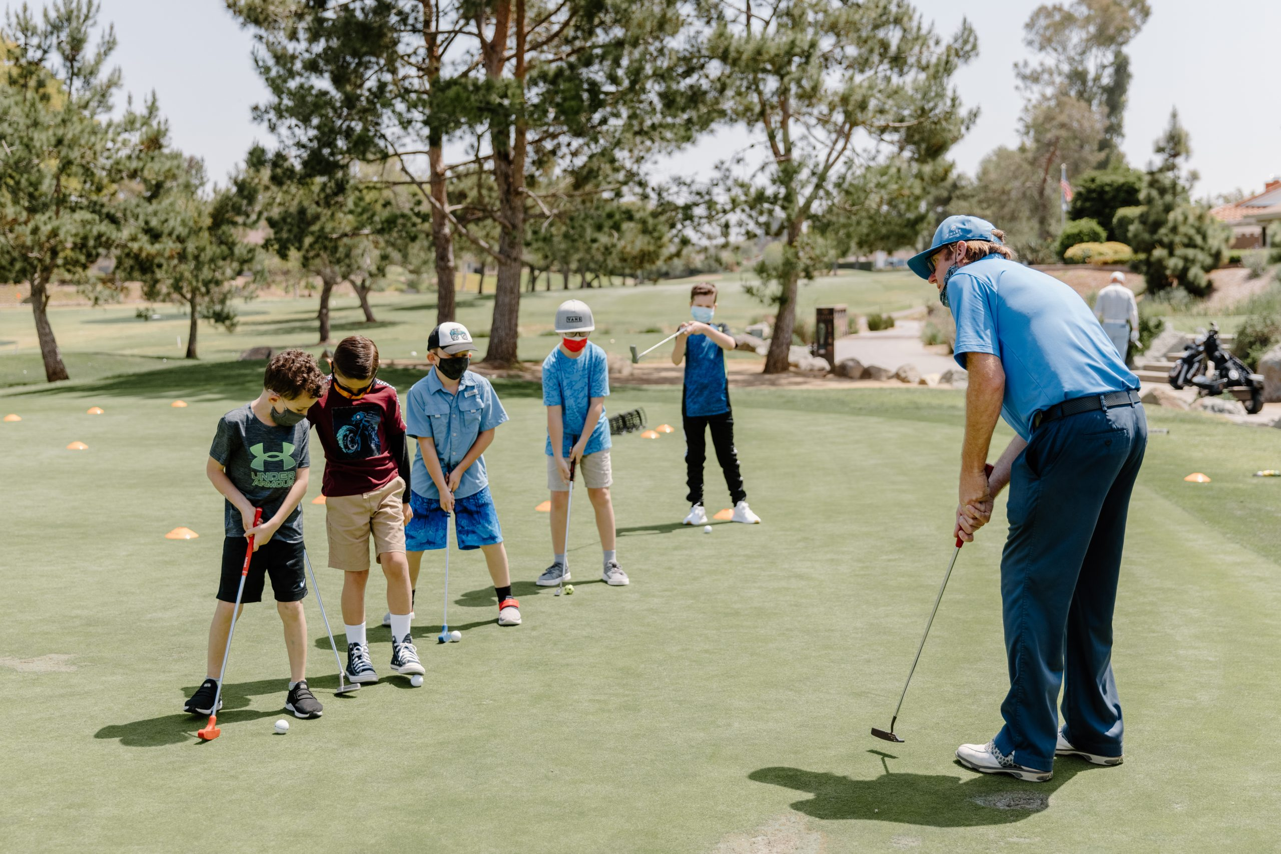 Kids getting a golf lesson